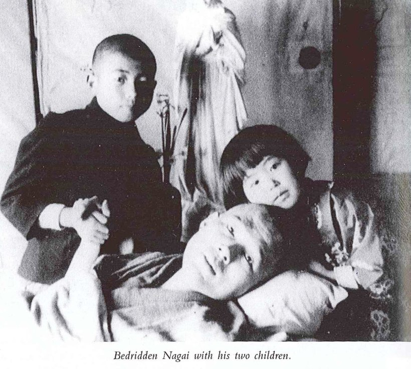 bedridden-nagai-with-his-two-children.jpg